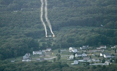 Mosquito pesticide containing PFAS contamination is aerially sprayed over land in New York